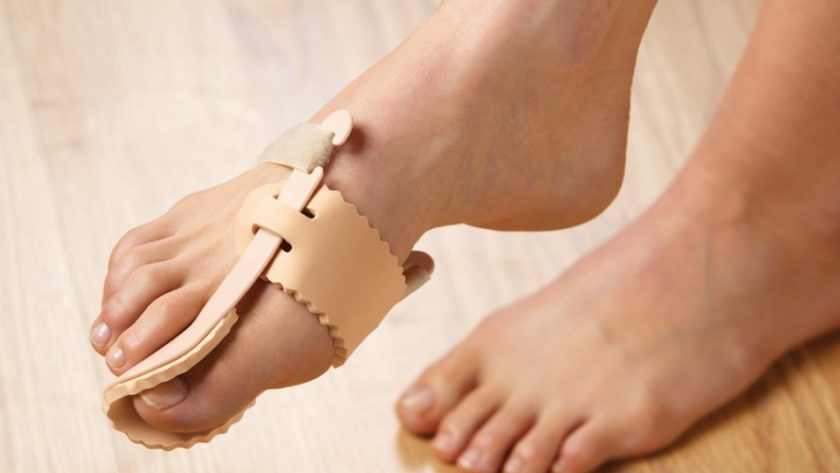 What causes bony protrusion in the big toe?